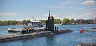 Nuclear-powered attack submarine USS Hampton arrives at the Portsmouth Naval Shipyard.