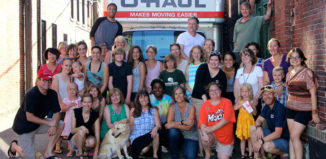 Fill the Hall organizers and volunteers pose in front of a U-Haul loaded with food donations outside The Music Hall in Portsmouth, NH, last summer.