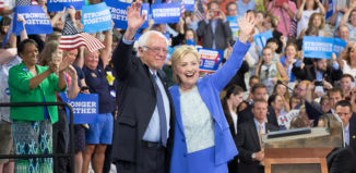 Bernie Sanders and Hillary Clinton share the stage at Portsmouth High School.