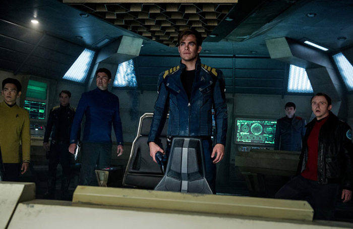 Chris Pine (center) may still be in charge of the Enterprise, but Simon Pegg (far right) takes control of the script in