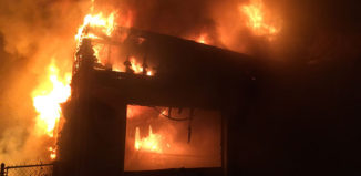 Fire consumed a house and garage on Leslie Drive early Thursday morning.