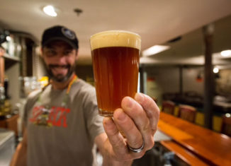 Portsmouth Brewery head brewer Matt Gallagher holds a fresh pint of Selkie.