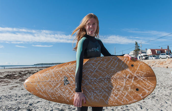Liz Cunningham tries out a Grain surfboard at Long Sands Beach.
