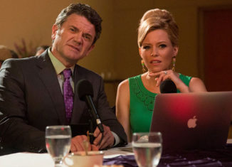 "John Michael Higgins with Elizabeth Banks in ""Pitch Perfect 2"""